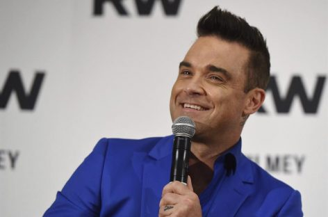 Robbie Williams y Black Eyed Peas estarán en concierto de Manchester